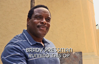 Photo of Chad Coleman playing Burn Notice TV character Agent Brady Pressman