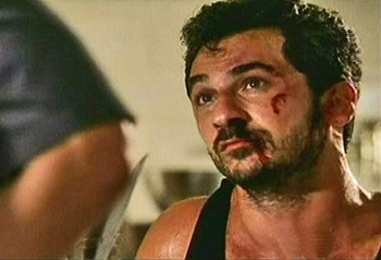 Photo of Michael Aronov playing Burn Notice TV character Vlade / Serb
